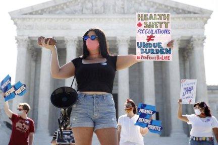 Pro-Life Demonstrators - Sign Reads Health+ Safety Regulation DO NOT EQUAL Undue Burden