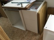 """A 24"""" sink cabinet and a 15"""" drawer stack."""