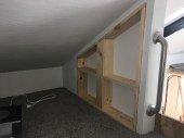 Adding trim to make a bookshelf area in the little loft.