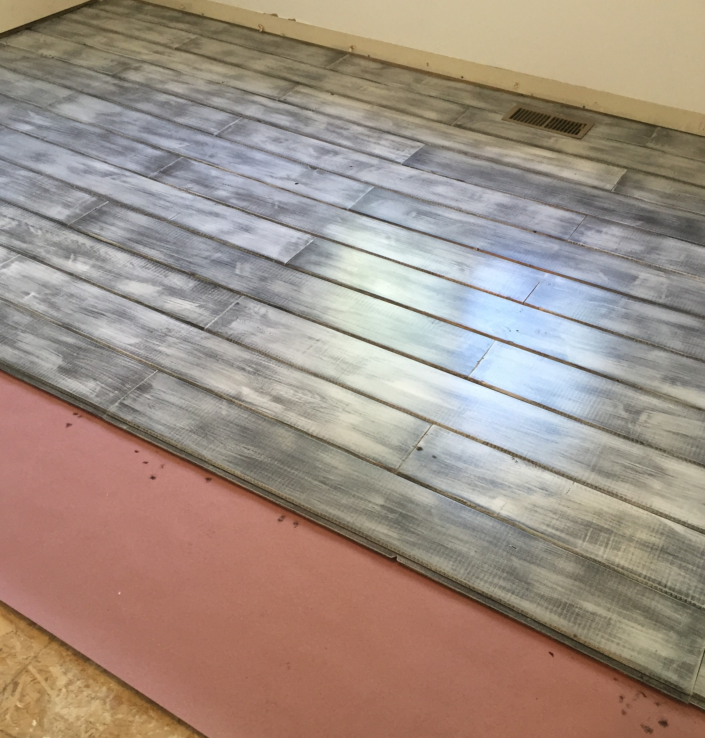 Flooring being layed down using car-siding.