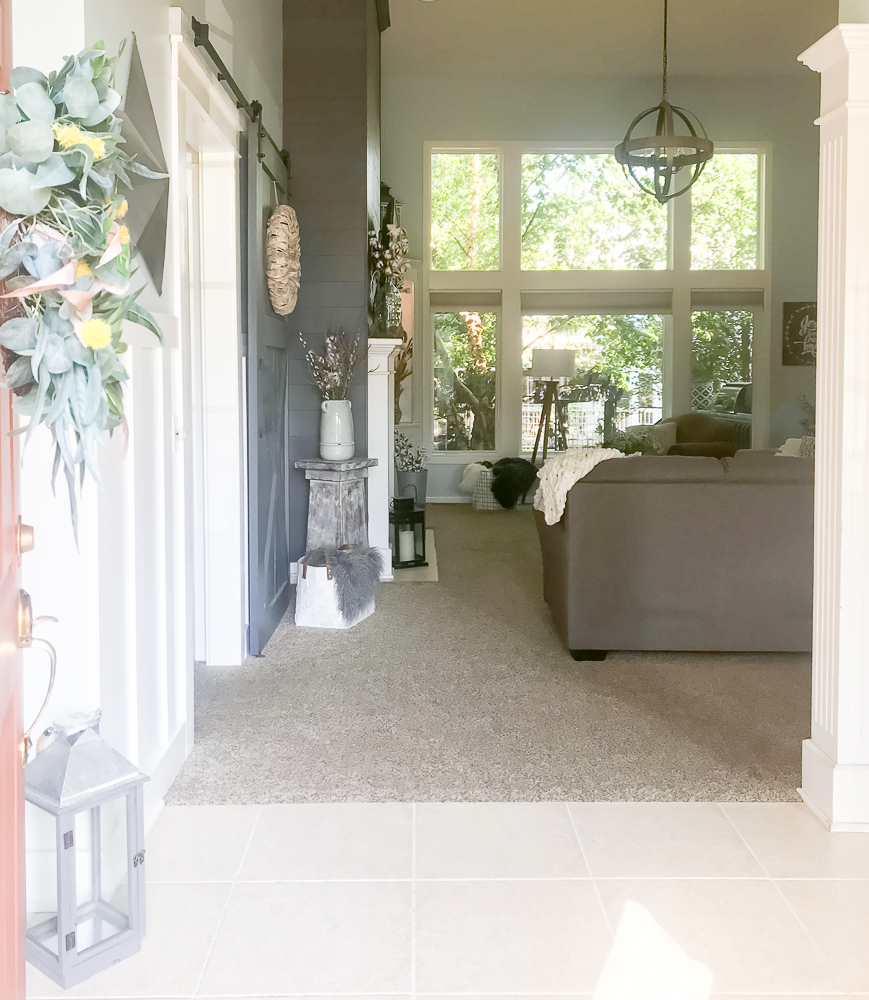 Entry way to a farmhouse home with fall decor