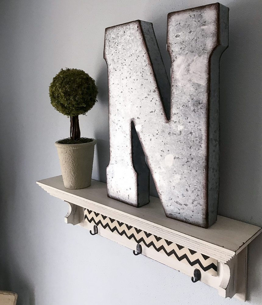 Fall topiary and metal letter N on shelf