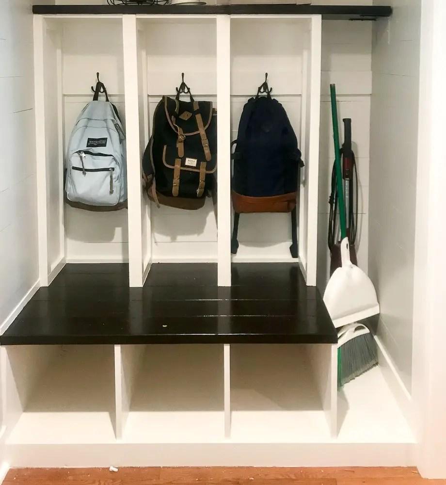 mudroom lockers with heavy backpacks hanging on hooks