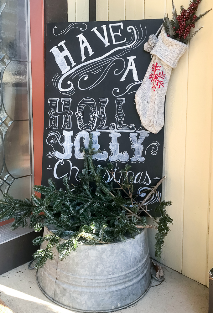 Free hand chalkboard sign on front porch