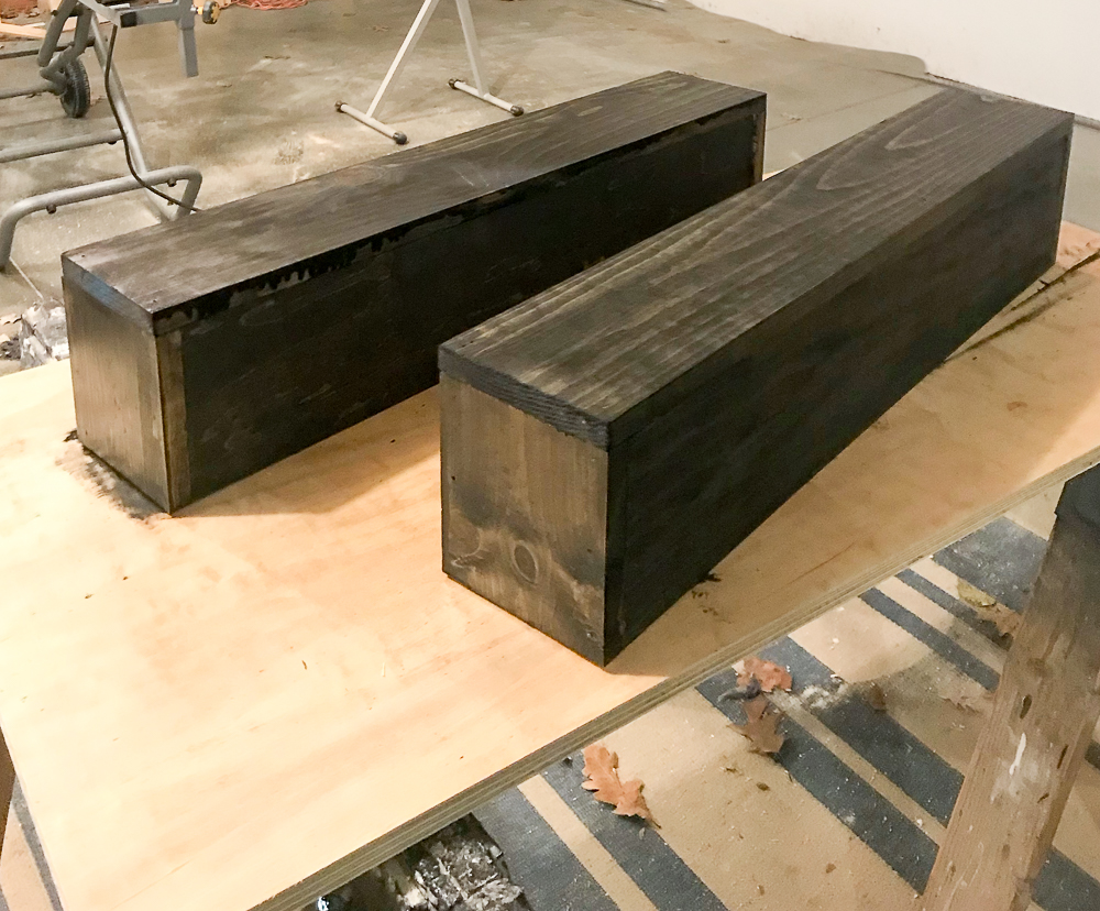two wooden boxes stained