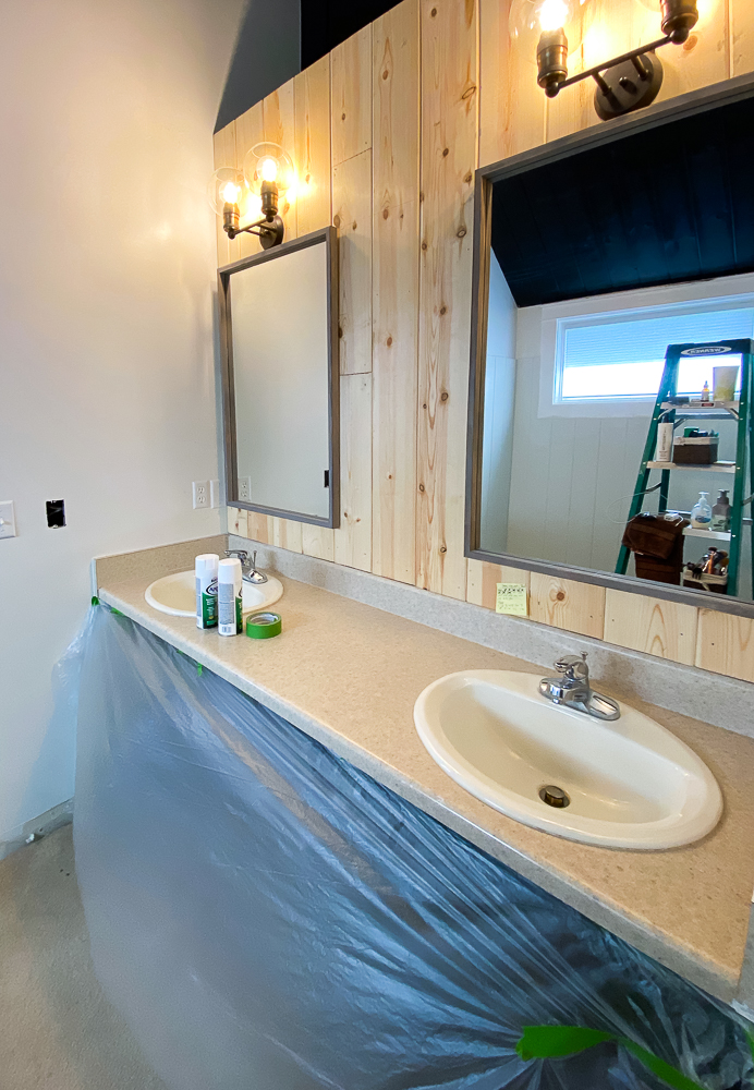 Makeover Projects Bathroom lights hung along with mirrors