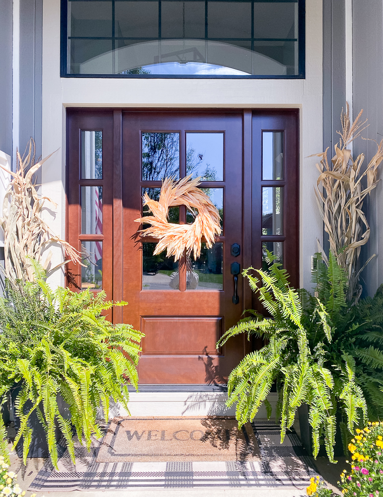 front porch with ferns and corn husks