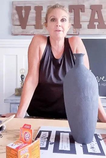 lady standing behind black pot