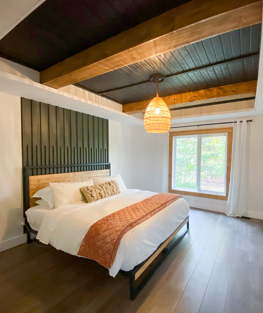 Large bedroom with king size bed and large pendant light