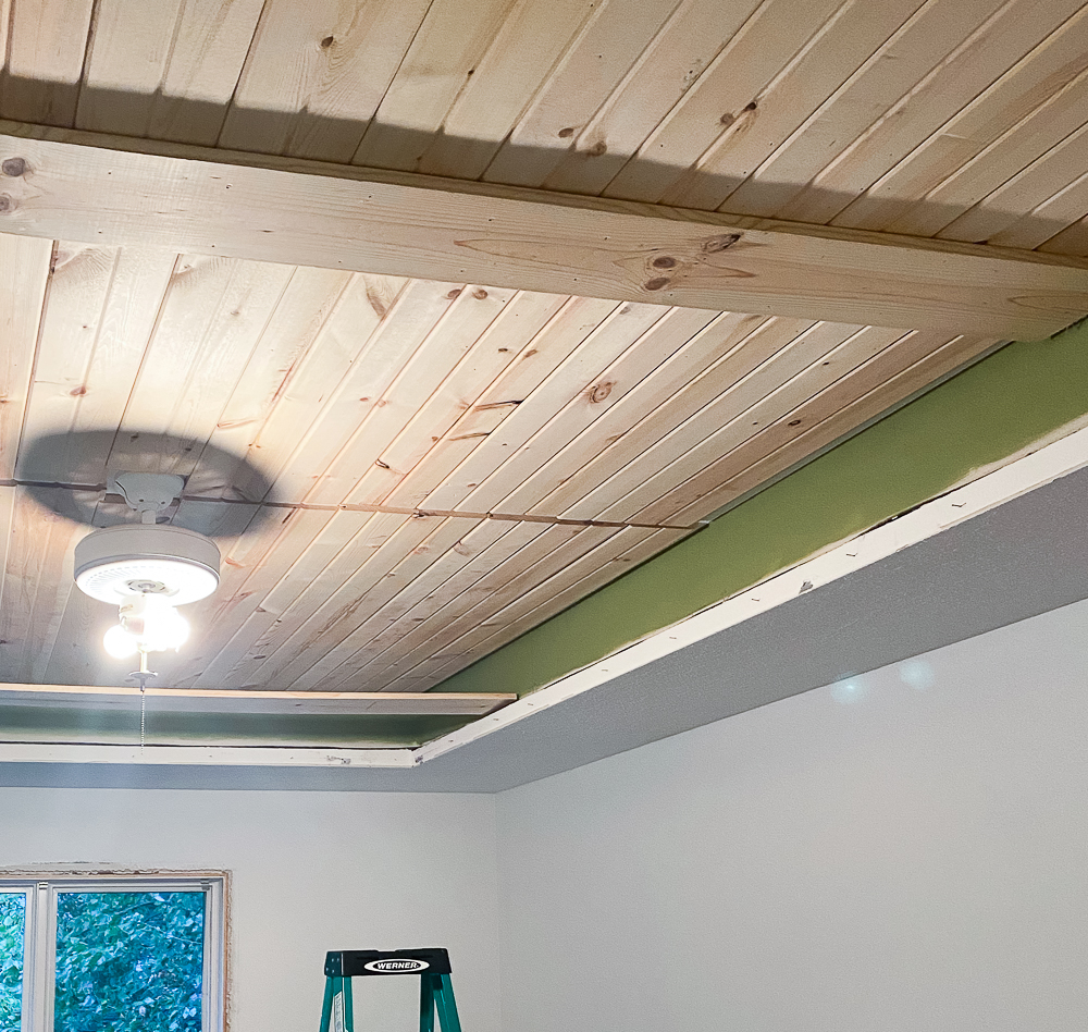 Carsiding in tray ceiling with beams anchor board attached