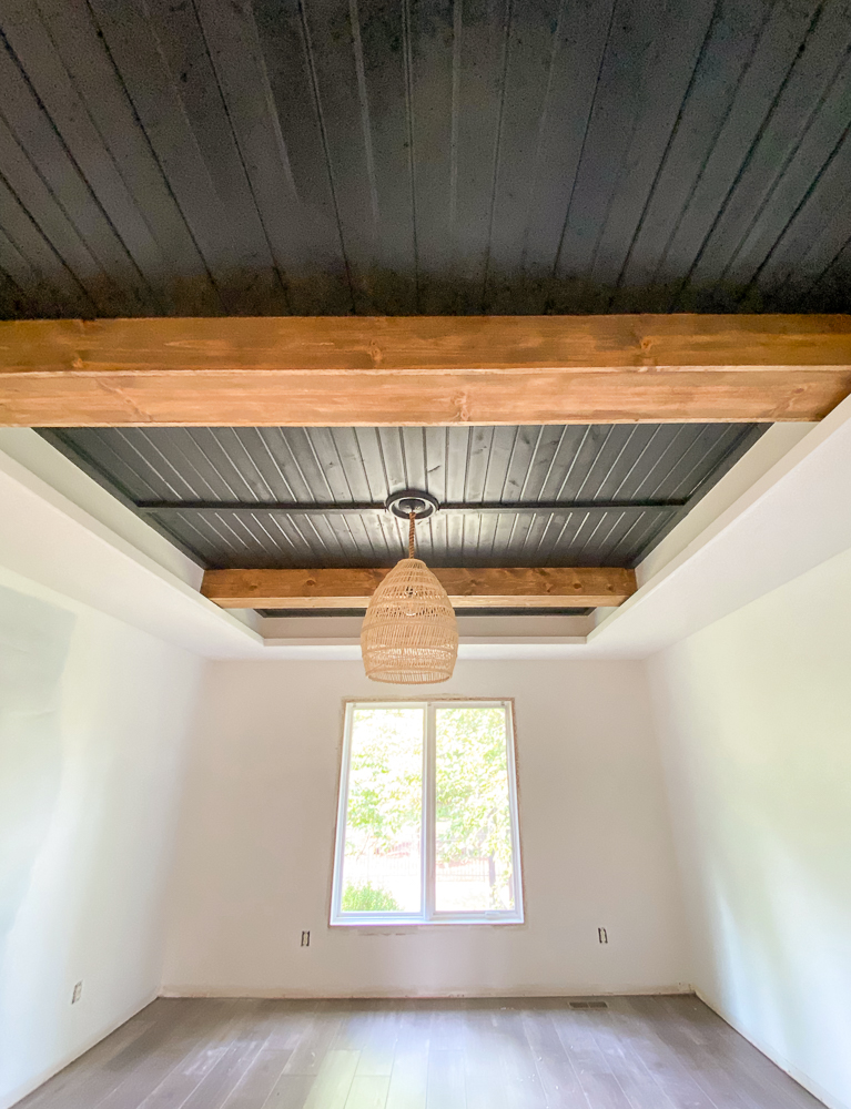 Carsiding tray ceiling with faux beams and basket light