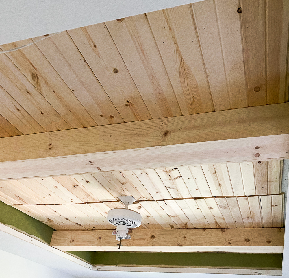 tray ceiling with carsiding and faux beams