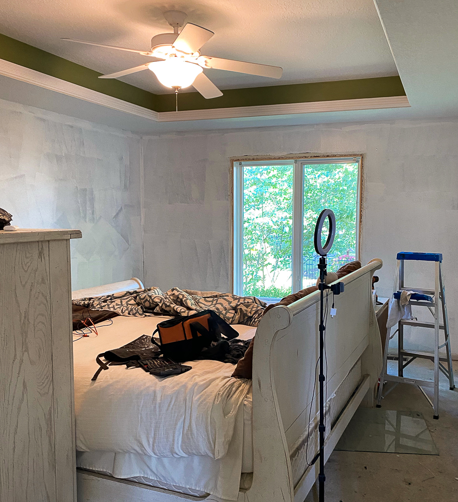 messy master bedroom before makeover