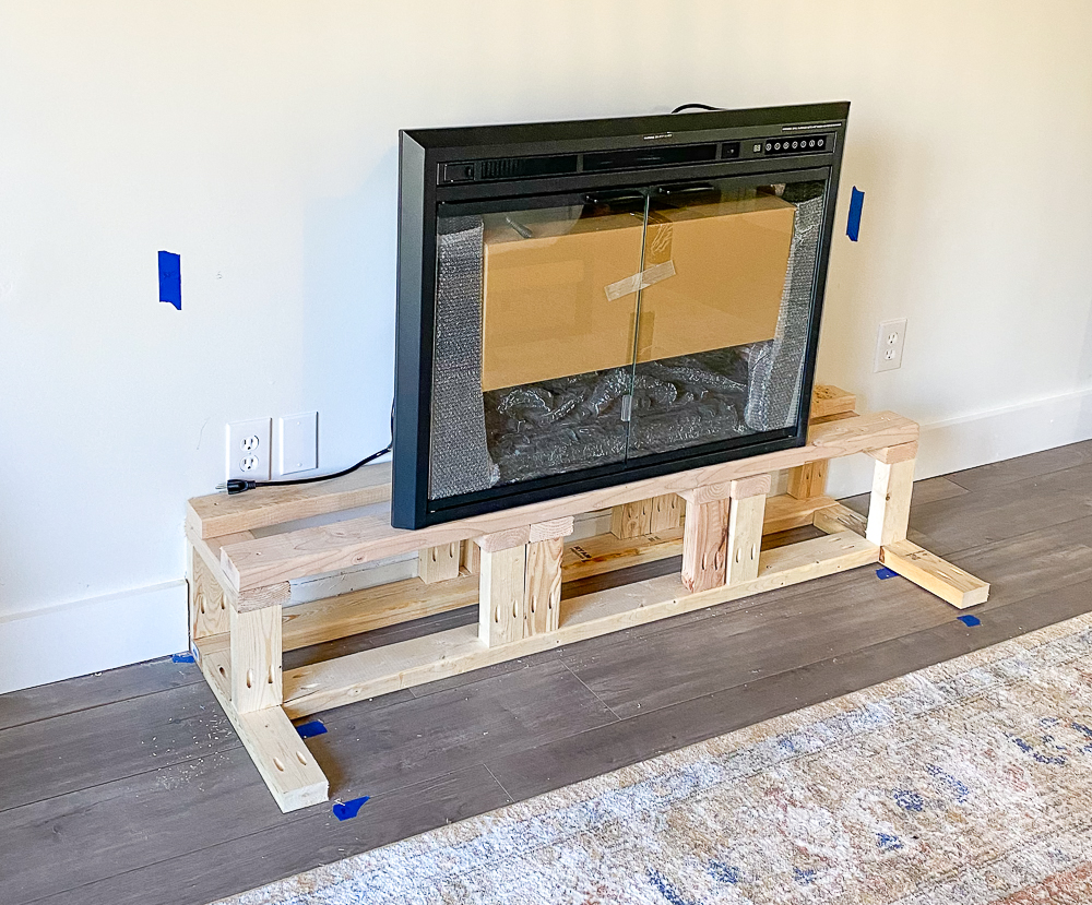Fireplace insert placed on top of build a fireplace base