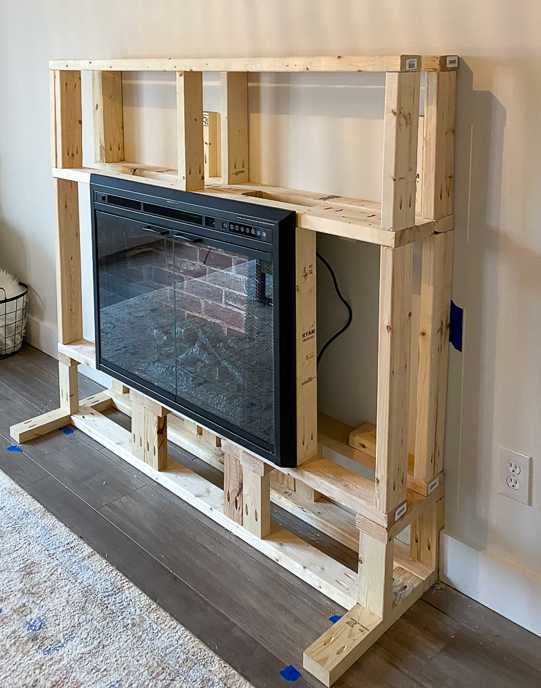 2x4's built around electric fireplace insert