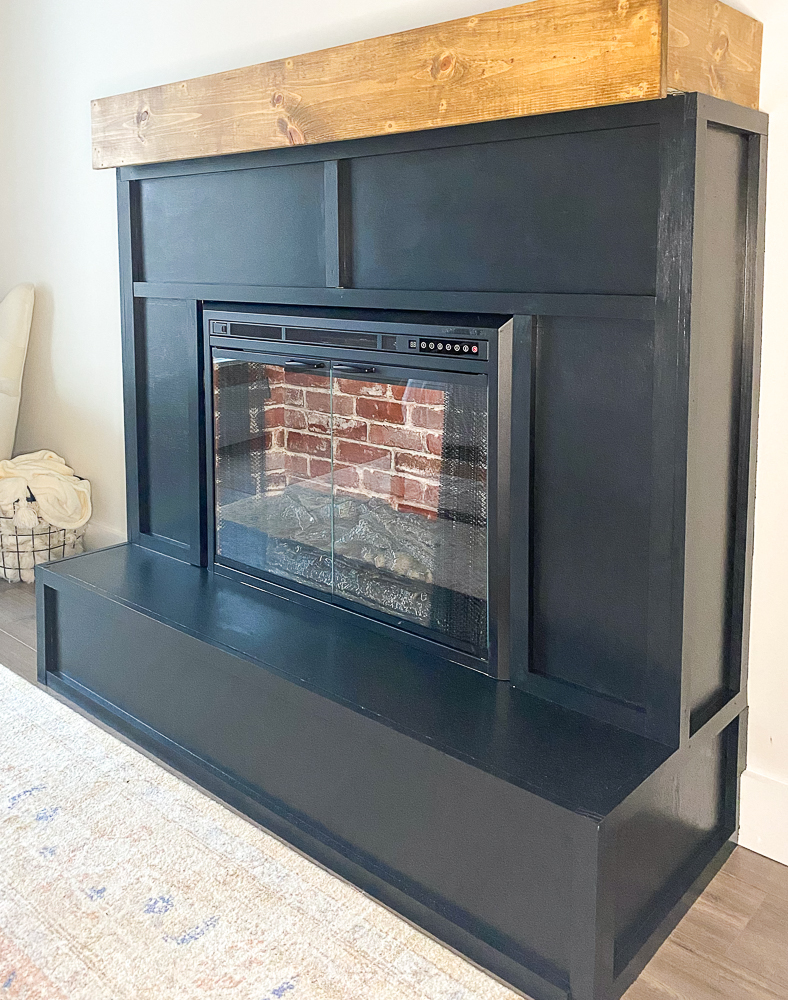 electric fireplace insert with red faux brick