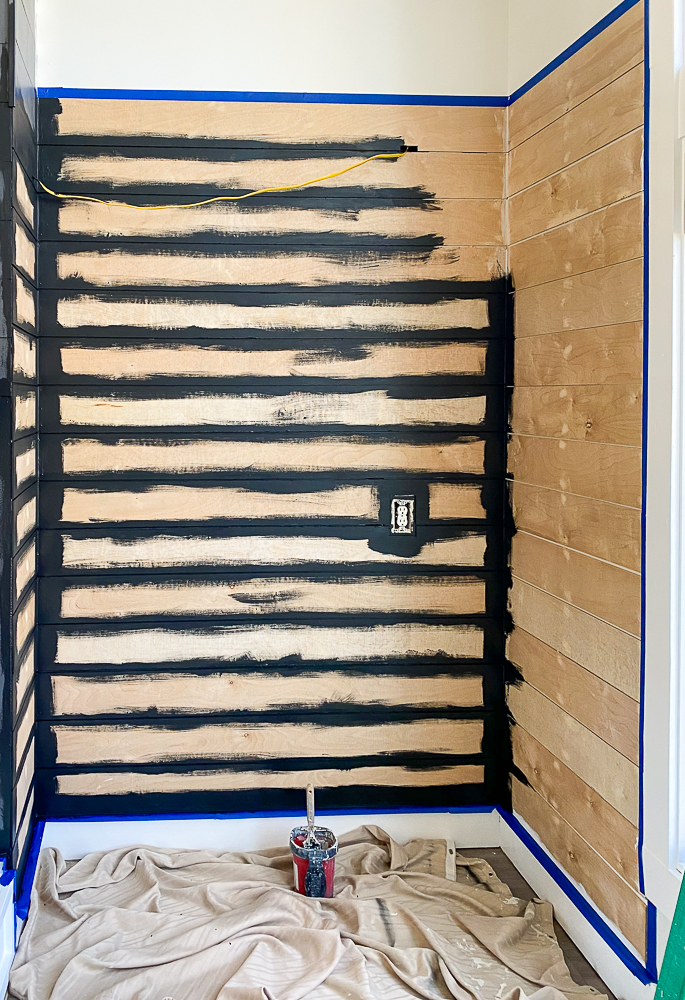 Shiplap wall with black paint in between each board