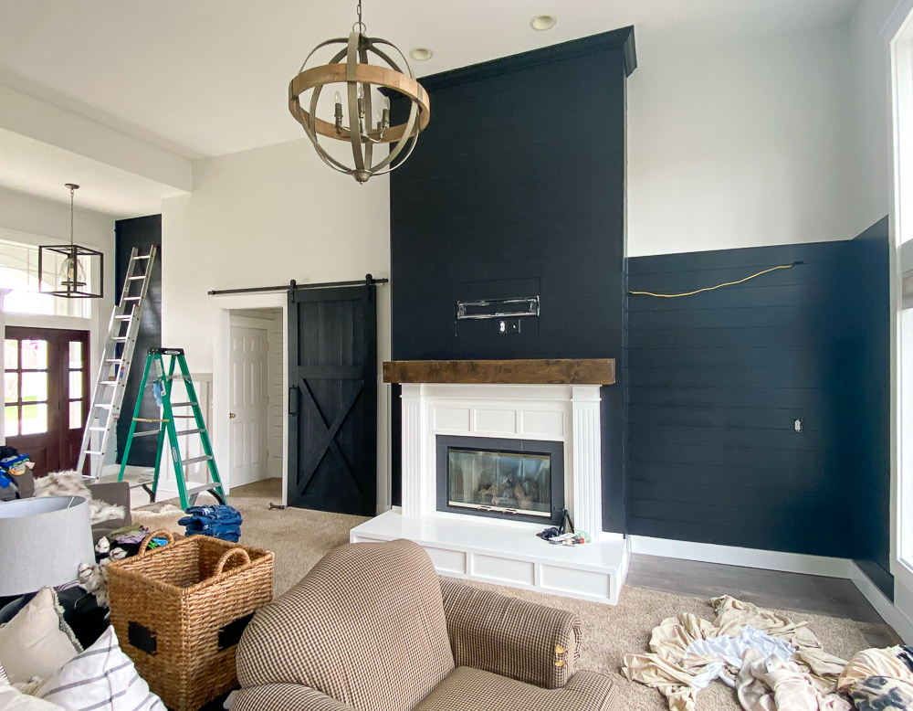 Corner cabinet removed and black painted shiplap walls added. A full view of the entire open space