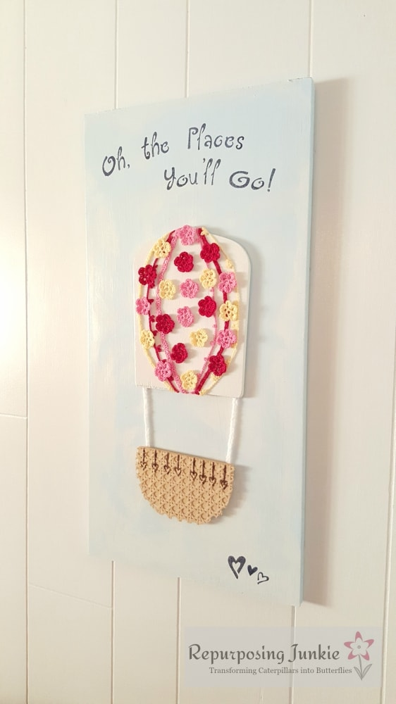Repurposed Ceiling Fan Blades into Hot Air Balloon Wall Art, Crocheted Red, Yellow, and Pink Flowers, Oh the Places You'll Go Quote, Hearts, Blue and White Sky, and Cane Basket