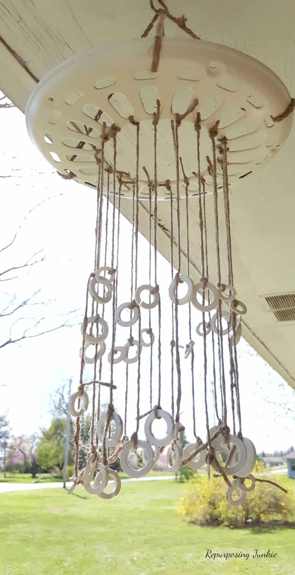 Rustic Wind Chime from Repurposed Materials using Ceiling Fan Cover and Washers and Jute Twine