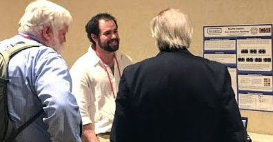 Matt Higger discusses Shuffle Speller with Gregg Vanderheiden and Denis Anson at the RESNA 2017 Conference.