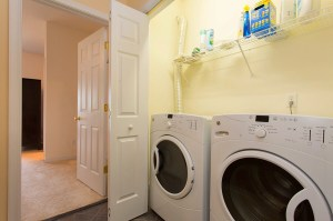Roomy Washer and Dryer Closet with Wire Shelving