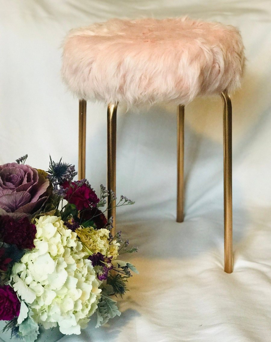 Feeling cozy is essential and faux fur is exactly the material that can add coziness at once, besides, it's timeless and fits many interiors, from boho chic to glam ones, so even when the winter finishes, you'll be able to keep the piece and not hide it.