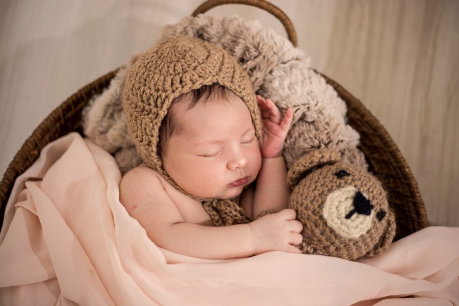 The American Academy of Pediatrics (AAP) recommends keeping soft objects and loose bedding out of the sleeping area for at least the first 12 months.