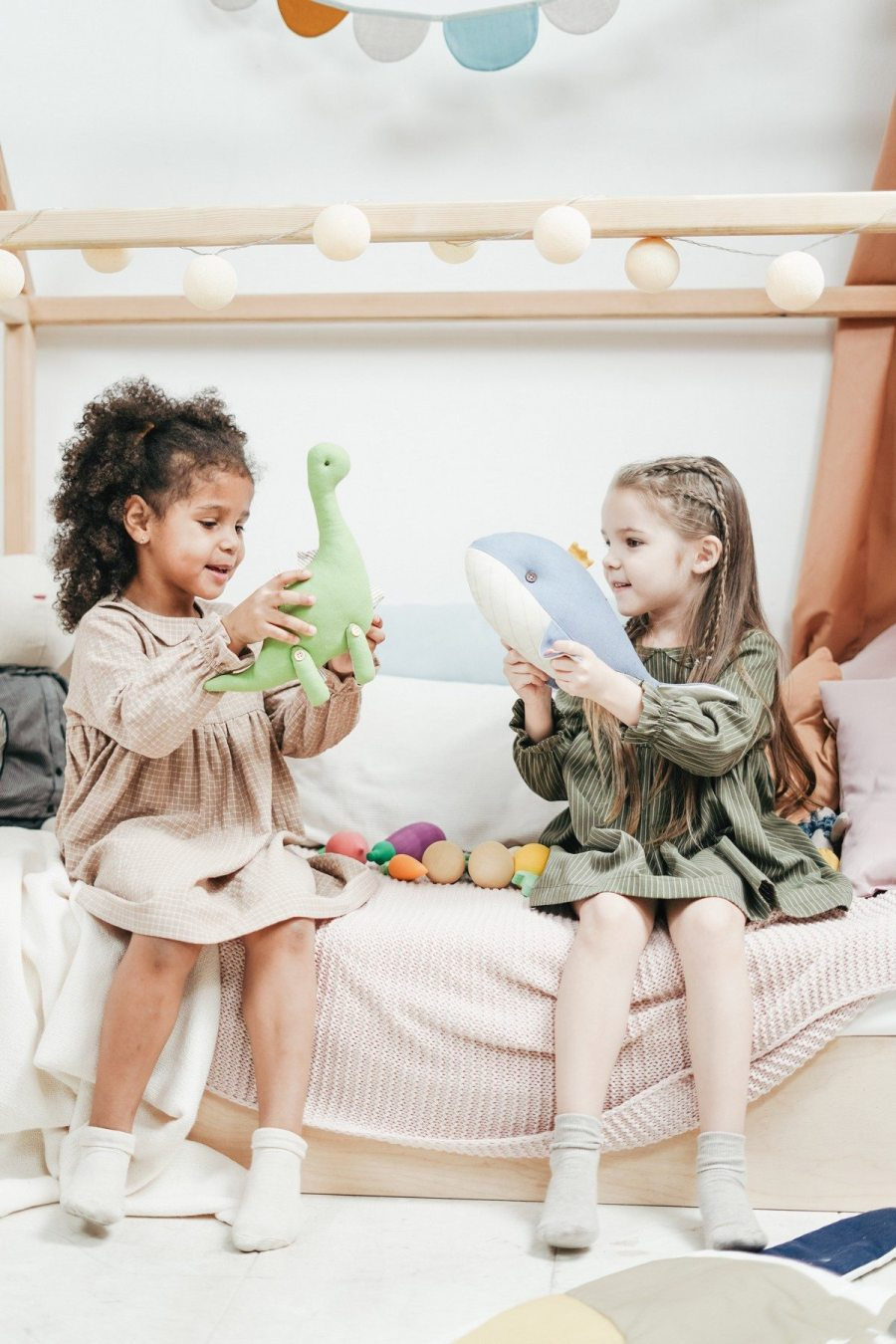 Your child should continue to sleep with their plushies as long as he likes it! Children have their own schedule for growing up and its much slower than some adults have the patience for.