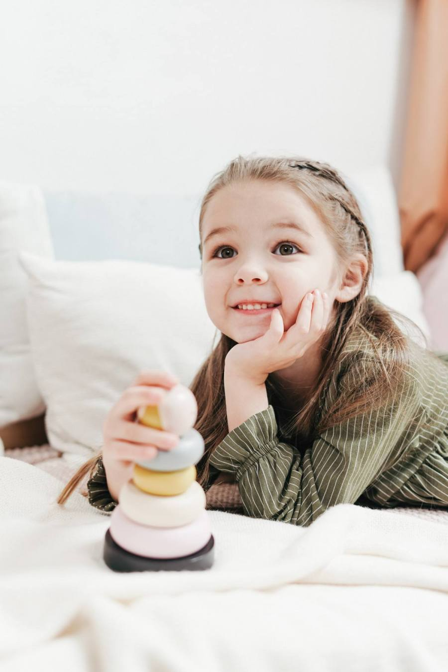 Stacking toys - Oh how I love thee! Let me count (and stack) the ways.   Don't be deceived - these seemingly simple toys pack a big punch when it comes to early learning development.