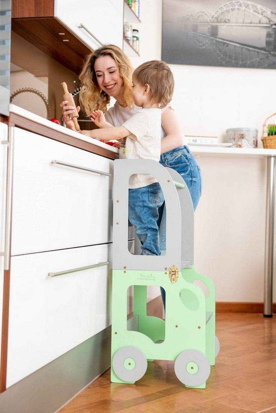 A learning tower (also known as a kitchen buddy) is a step stool designed to be used in the kitchen by toddlers. Unlike a regular step stool, a learning tower has safety features that make it safer for young children who make be subject to losing their balance.
