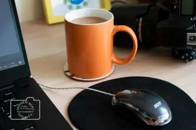 Contact A mug of tea, laptop and a DSLR camera