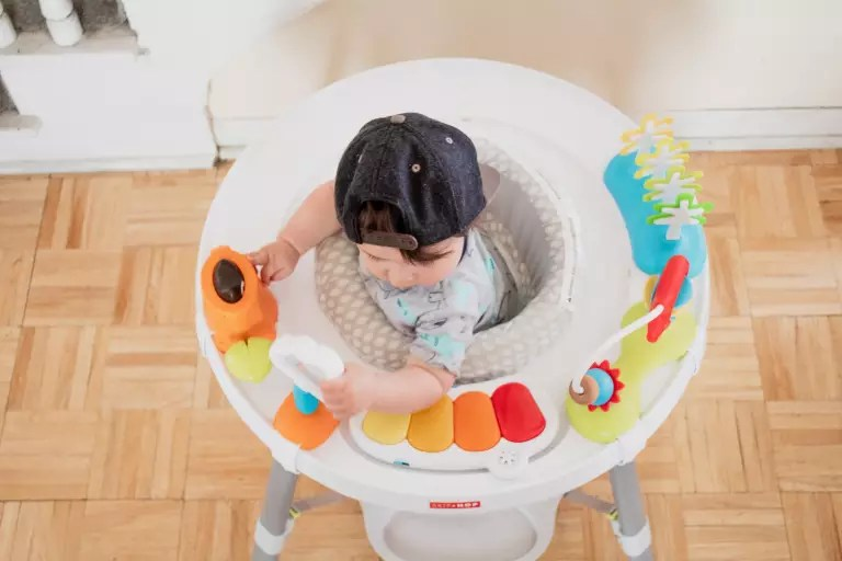 revolving chair for baby swing alibaba best activity centers babies and toddlers