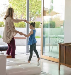 mother and daughter dancing to connected whole home distributed audio speakers [ 2000 x 1600 Pixel ]