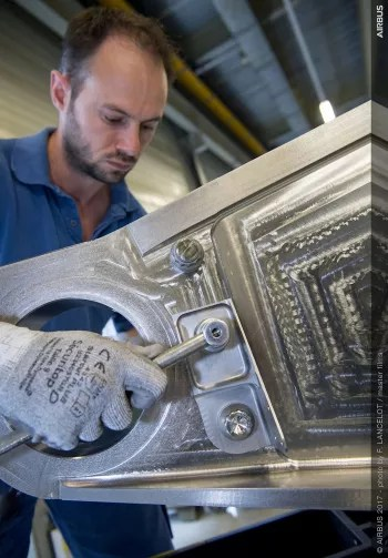 The 3D-printed titanium bracket assembly, produced by laser powder bed fusion and installed on a commercial A350 XWB aircraft. (Image courtesy of Airbus.)