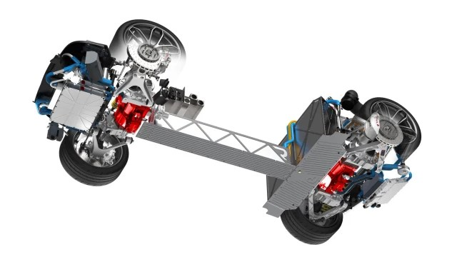 A CRITICAL ASPECT of the full-electric driveline is that each wheel is driven by its own engine. In the picture, the red parts mark the engine compartments, with two motors in each wheelhouse—one in the front and one in the rear.
