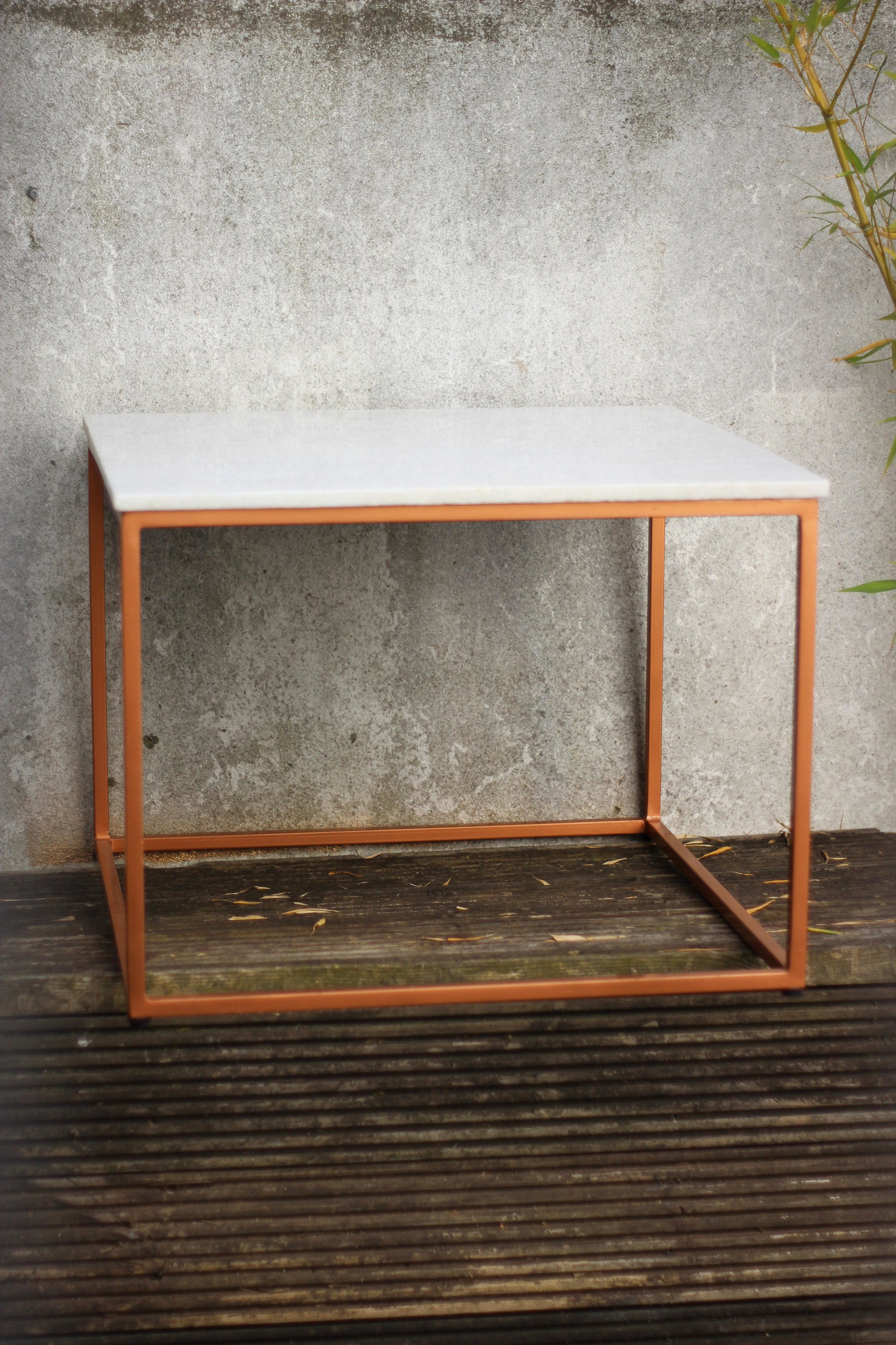 white marble and copper coffee table