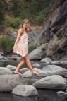 Barefoot Woman In Summer Dress Walking Creek