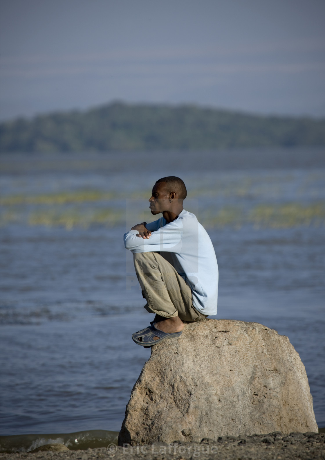 oromo man sitting alone