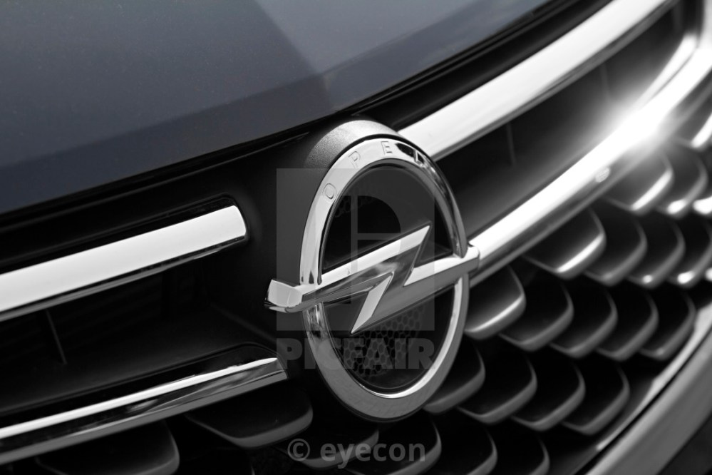 medium resolution of  closeup of the opel logo on a the front of the car stock image