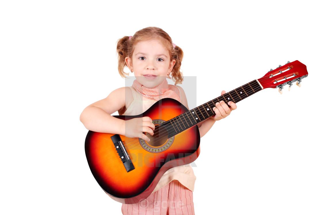 little girl play acoustic