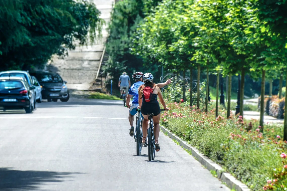 Two bike riders on a road