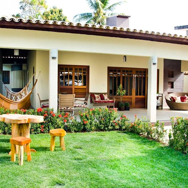 Casas de estilo translation missing: ve.style.casas.tropical por Celia Beatriz Arquitetura