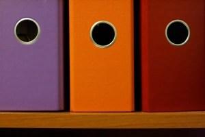 Some binders on the shelf