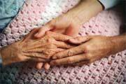 Holding hands of elderly woman