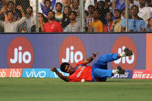 Munaf Patel of the Gujarat Lions dives to stop the boundary during match 16 of the Vivo 2017 Indian Premier League between the Mumbai Indians and the Gujarat Lions held at the Wankhede Stadium in Mumbai, India on the 16th April 2017 Photo by Vipin Pawar - IPL - Sportzpics