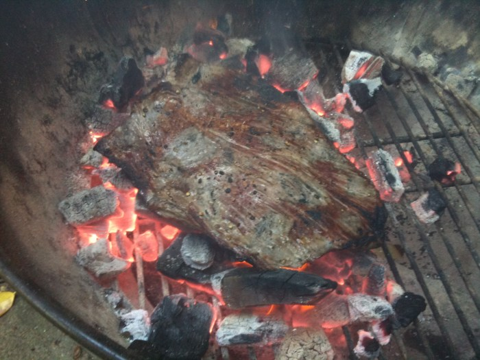 Skirt steak cooked directly on charcol
