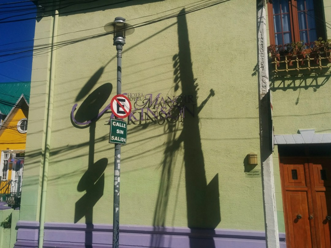 Sunlight and shadows on colored building