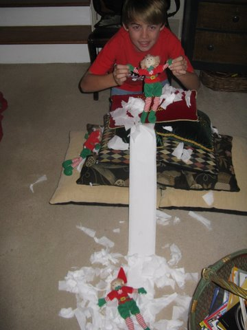 elves having fun with toilet paper