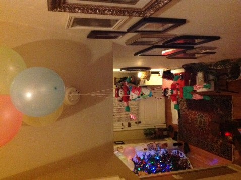 elves floating away on helium balloon